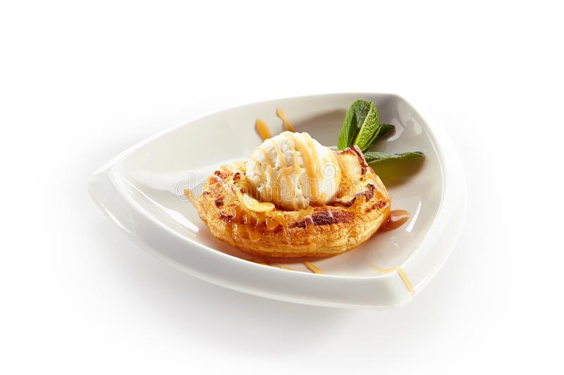 Apple Pie or Tart Topped with Ice Cream Ball royalty free stock photo