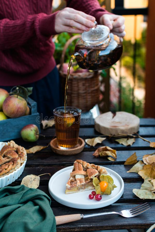 Apple pie and teapot with black tea, thanksgiving royalty free stock image