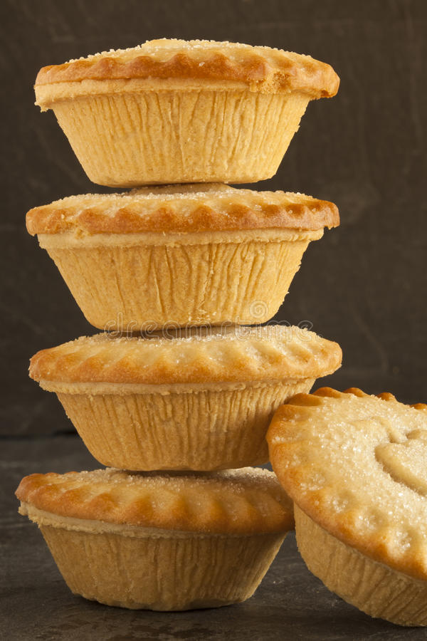 Apple pies. Five apple pies, four of which are in a stack royalty free stock photos