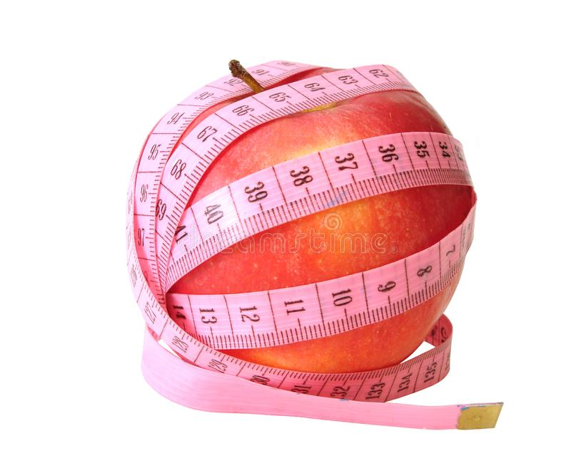 Apple with pink tape measure royalty free stock photography