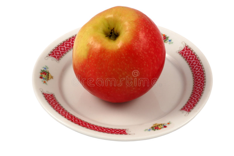 Apple on Plate. Isolated with clippingpath included stock images