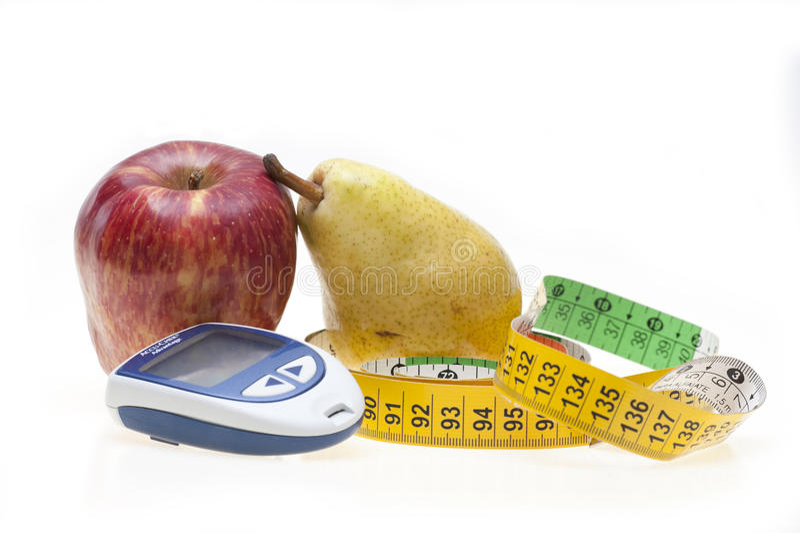 Apple, poire, bande et glucometer image stock