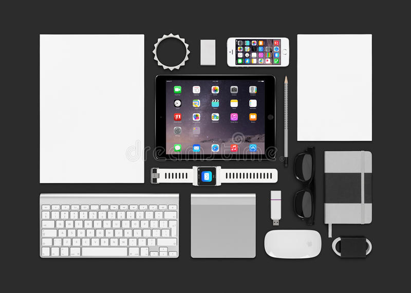 Apple products mockup consisting ipad air 2, iphone 5s, keyboard. Varna, Bulgaria - February 10, 2015: Top view of Apple products mockup. Consists of ipad air 2 royalty free stock photography