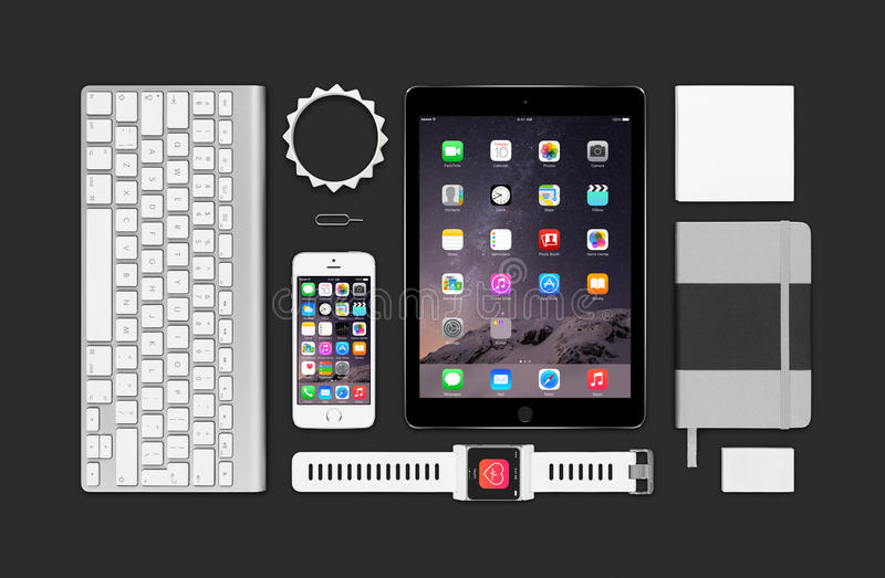 Apple products mockup consisting ipad air 2, iphone 5s, keyboard. Varna, Bulgaria - February 09, 2015: Top view of Apple products mockup. Consists of ipad air 2 royalty free stock photography