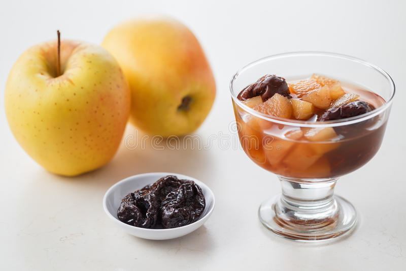 Apple & Prune Compote. Apple and prune compote, on white table stock images