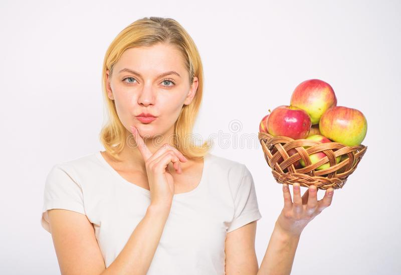 Apple recipes to make this fall. Girl hold basket apples white background. Culinary recipe concept. Woman thoughtful stock photography