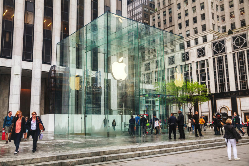 Apple retail store in New York City. NEW YORK CITY - MAY 12: Entrance to Apple retail store with people on May 12, 2013 in New York. The Apple Store is a chain royalty free stock photos