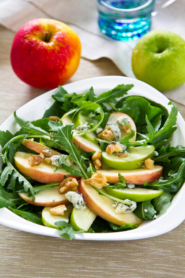 Apple,Rocket and Blue cheese salad. Fresh Apple,walnut Rocket and Blue cheese salad stock images