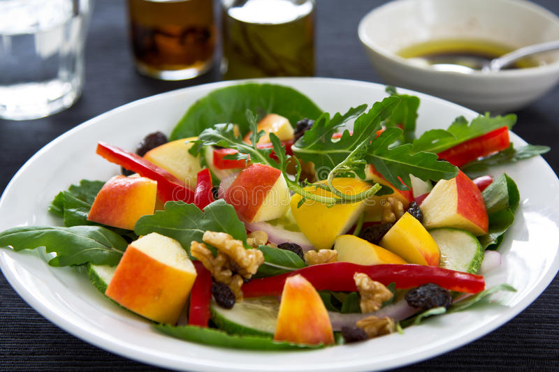 Apple,rocket and walnut salad. With Balsamic dressing stock images