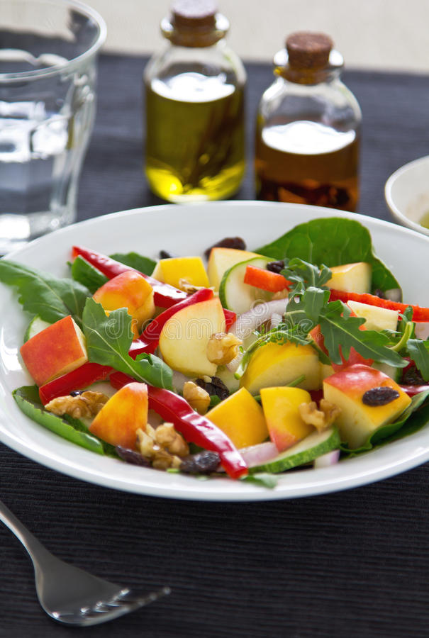Apple,rocket and walnut salad. With Balsamic dressing royalty free stock photos