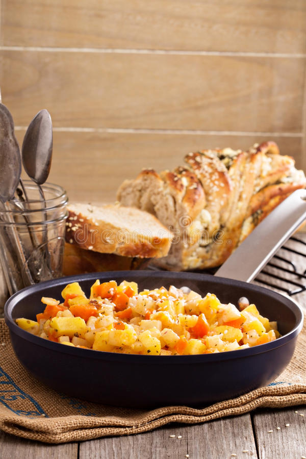 Apple and root vegetable hash stock image