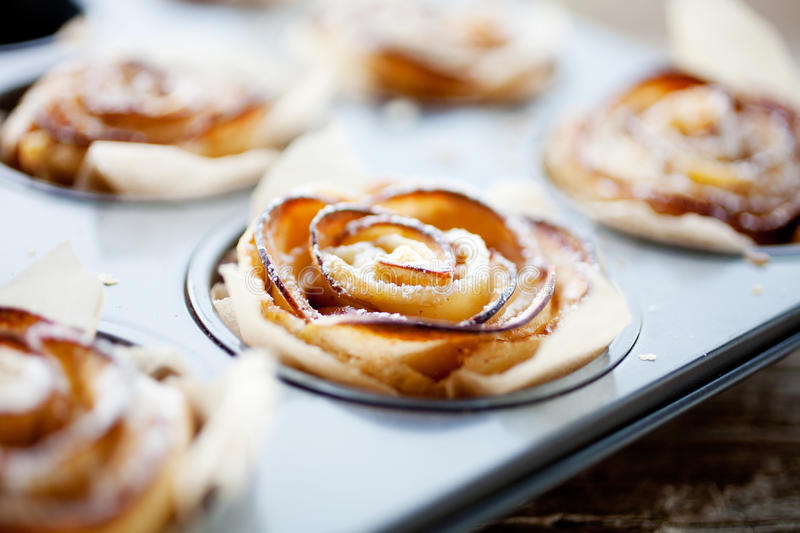 Apple rose. Delicious and beautiful apple rose puff pastries stock photo