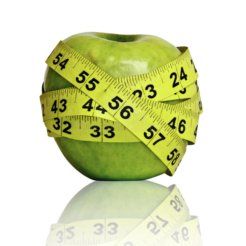 Apple with ruler. On white stock images