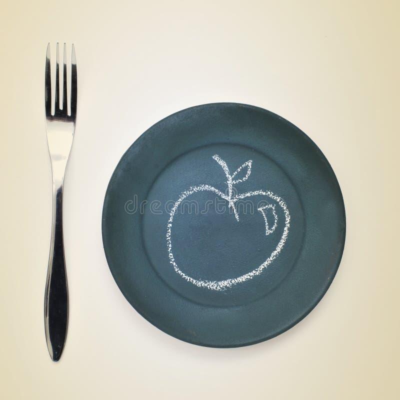 Apple rysujący z kredą w talerzu obraz stock