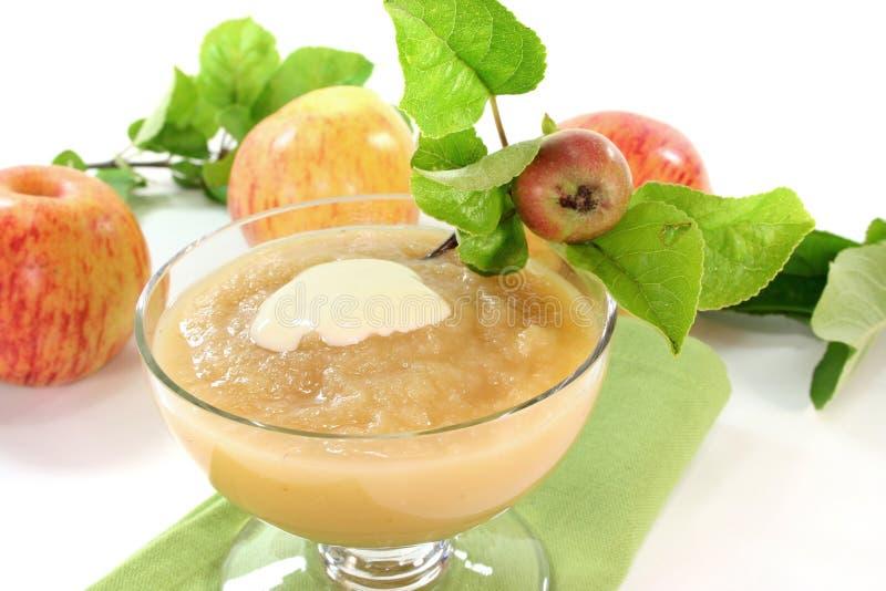Apple sauce with vanilla sauce stock photography