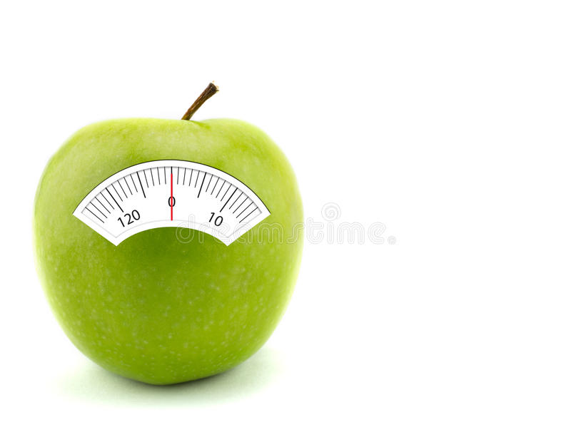 Apple with scales weight, . Apple with scales weight, on white background. healthcare concept stock photography