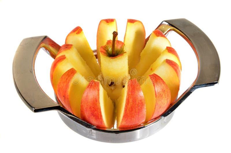 Apple-Schneidmaschine stockbild