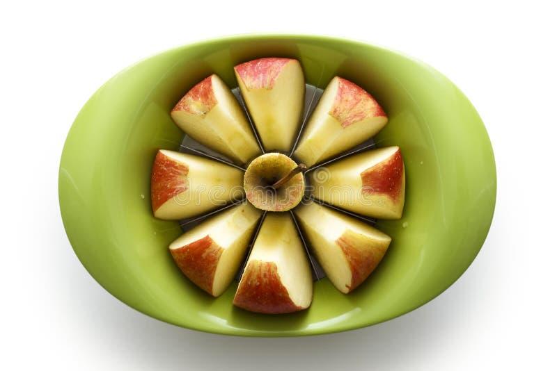 Apple-Schneidmaschine mit Apfel stockfotografie