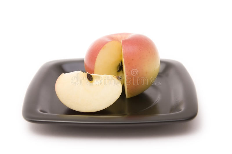 Download Apple And Segment On A Plate Stock Image - Image: 11586835