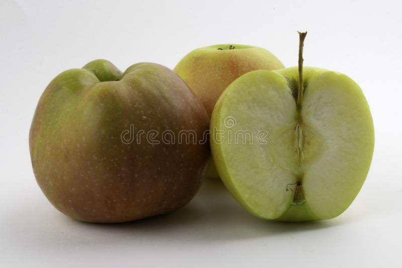 Apple and slice on white background royalty free stock image