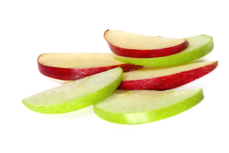 Apple Slices. On white background. Thin wedges of green granny smith and red delicious apples, makes a healthy snack royalty free stock photos
