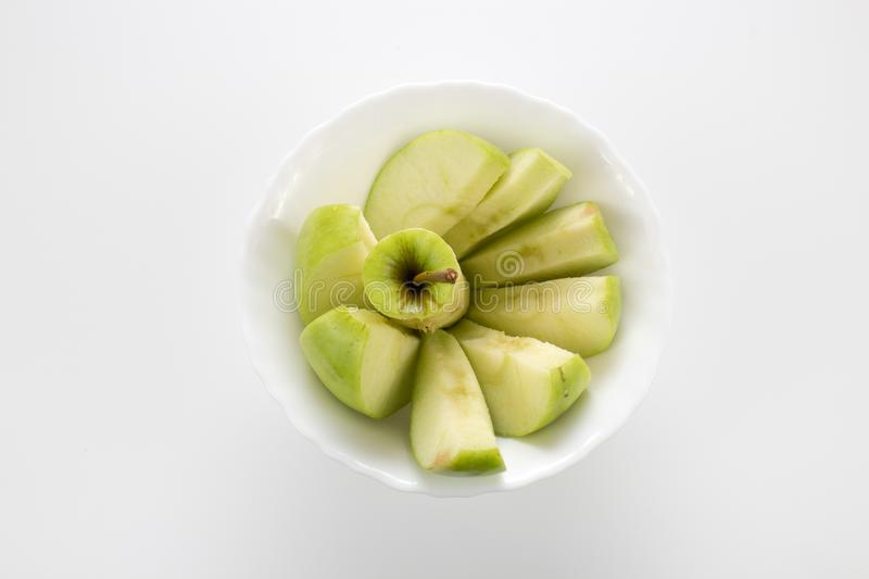 Apple slices in the little white bowl. Isolated background, multiple uses is possible stock images