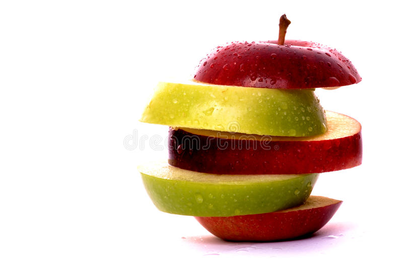 Apple slices in red and green. Isolated against a white background stock image