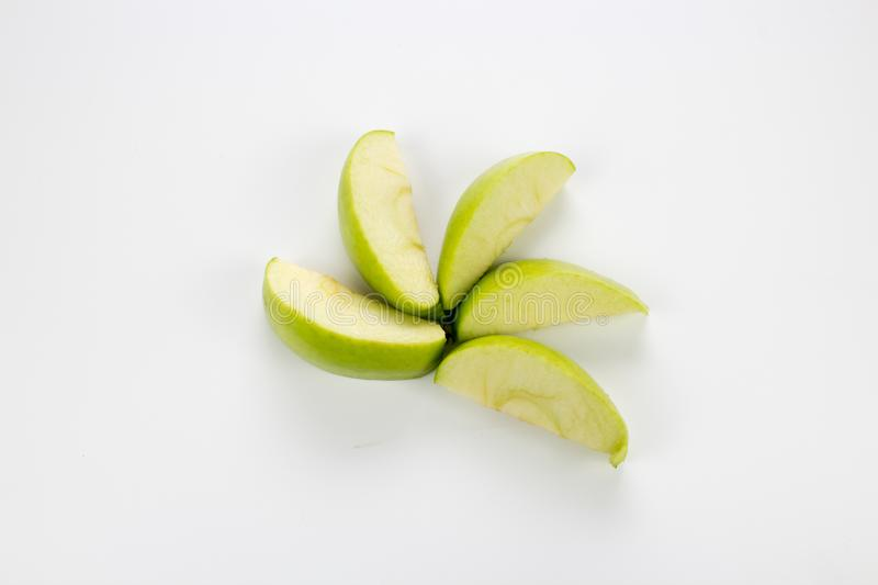 Apple slices on the table. Isolated background, multiple uses is possible stock image
