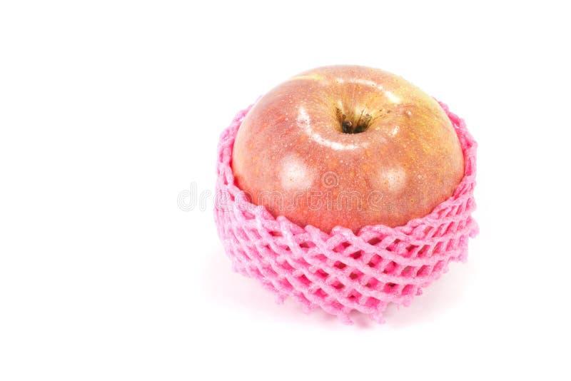 Apple slogg in med skumfrukt netto arkivfoton
