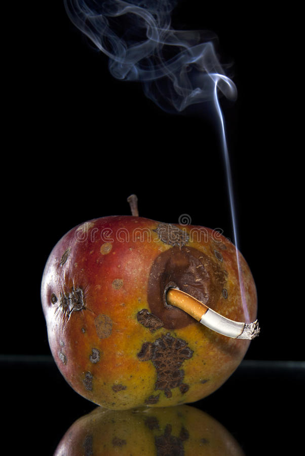 Apple And Smoking Look Like Worm Royalty Free Stock Photo