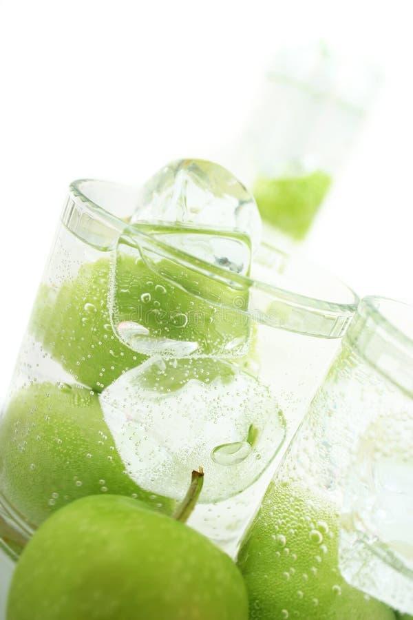 Apple in soda immagini stock