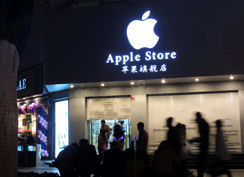 Apple store in China being closed with silhouettes of passersby stock photos