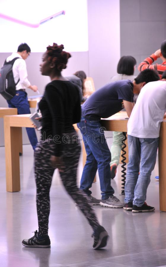 Apple Store on Chunxi Road. Apple store seen from the inside on Chunxi Road, downtown Chengdu,China.People buying Apple products in electronics store royalty free stock photo