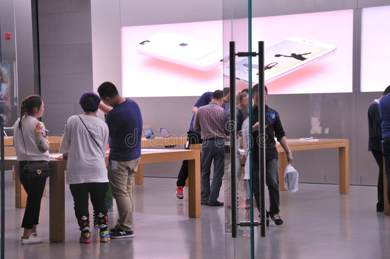 Apple Store on Chunxi Road. Apple store seen from the inside on Chunxi Road, downtown Chengdu,China.People buying Apple products in electronics store royalty free stock image