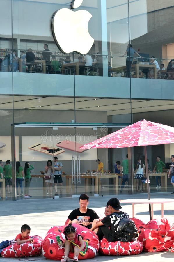 Apple Store on Chunxi Road. Apple store seen from the outside on Chunxi Road, downtown Chengdu.The visitor rested on beautiful stool royalty free stock photography