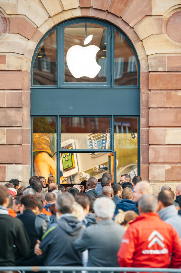 Apple Store - people waiting for product launch stock images