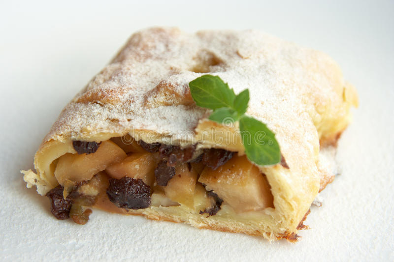Apple strudel. With raisins and mint leaves royalty free stock photos