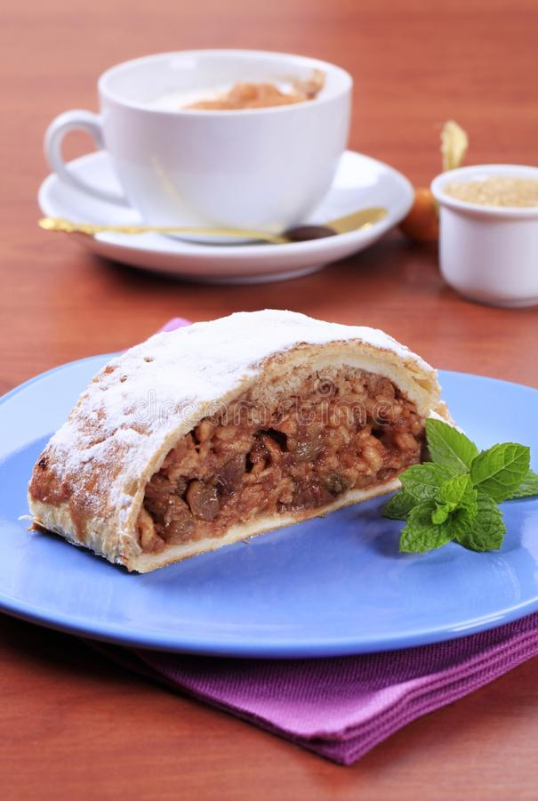 Apple strudel. Slice of apple strudel and a cup of coffee stock photo