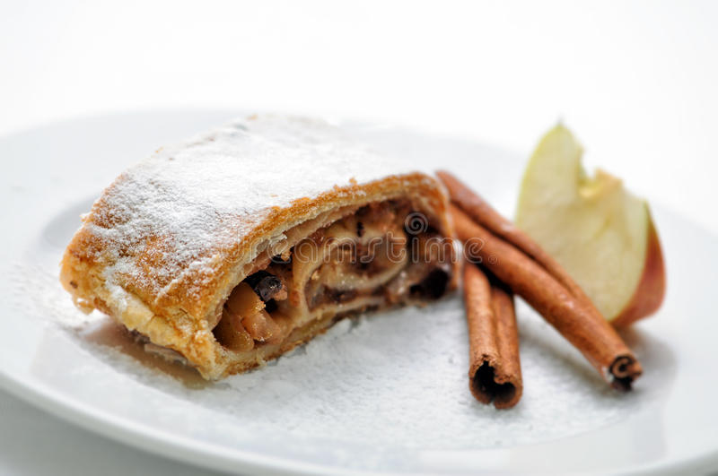 Apple strudel with cinnamon on white plate, product photography for patisserie or bakery, sweet cake.  stock image
