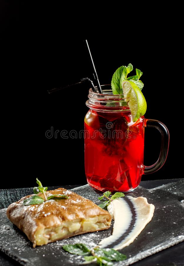 Apple strudel, garnished with mint and sprinkled with powdered sugar. stock photo
