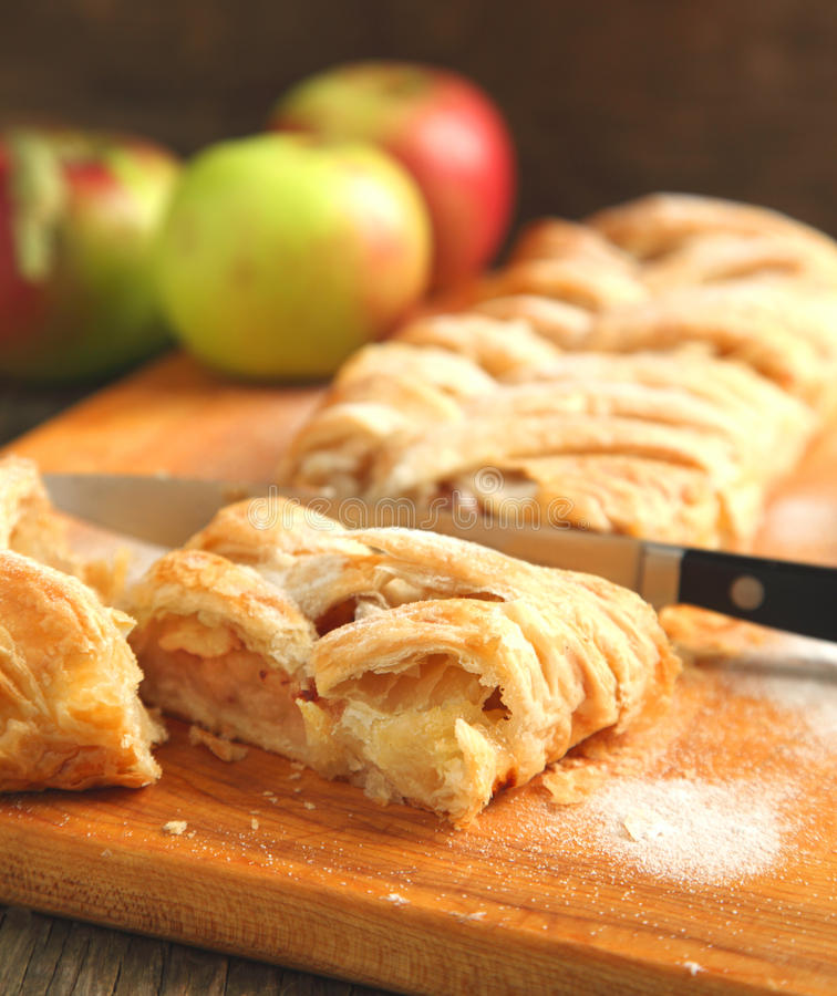 Apple strudel. Home bake Apple strudel on wooden board stock photography