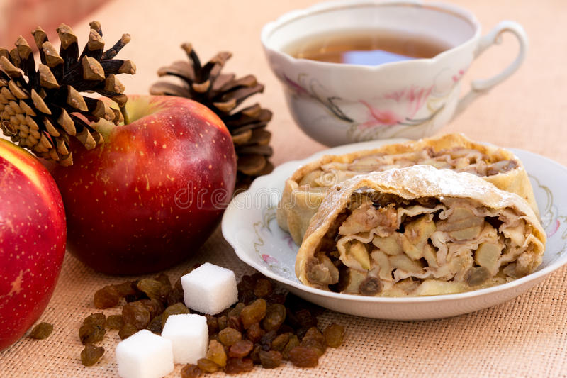 Apple strudel pie. Dessert with tea closeup royalty free stock images