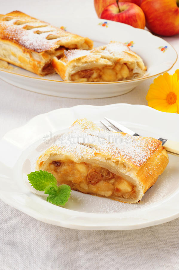Apple strudel. A slice of freshly baked Viennese apple strudel stock photos