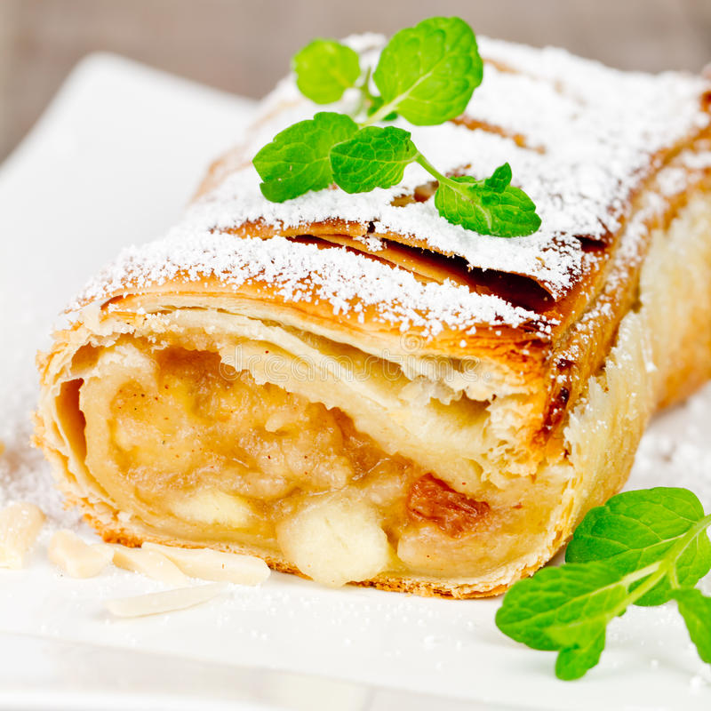 Apple strudel. With vanilla sauce royalty free stock images
