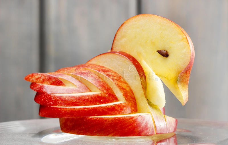 Apple swan. Decoration made of fresh fruit. stock images