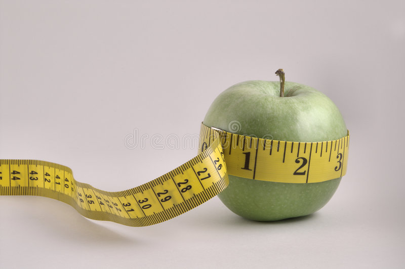Apple and Tailor's Tape royalty free stock photography