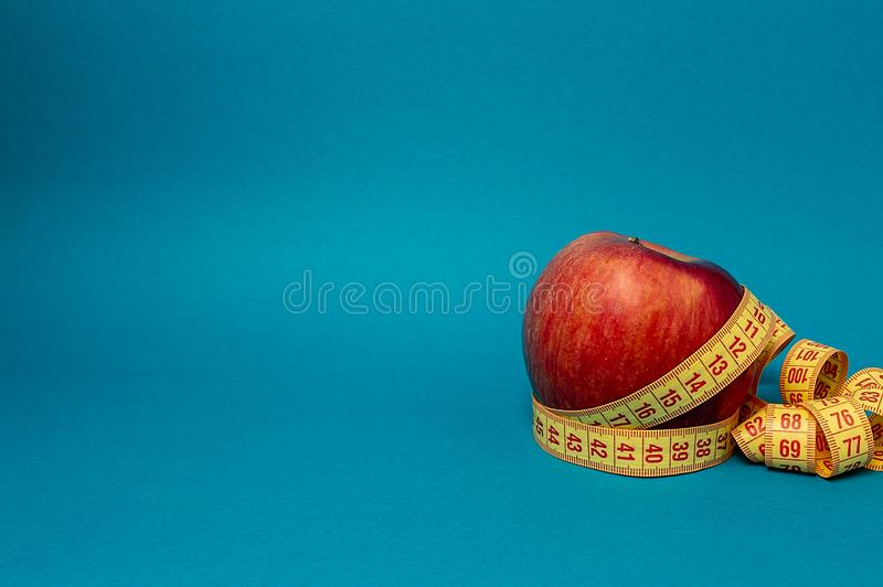 Apple and tape measure slim fitness diet sport life stock photos