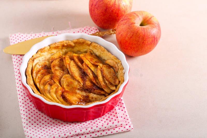 Apple tart. In a baking tin stock photo