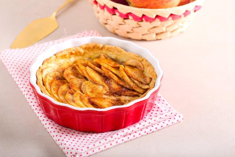 Apple tart. In a baking tin stock photos