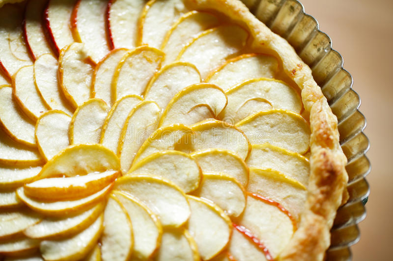 Apple tart detail with apple slices fanned in a pa royalty free stock images